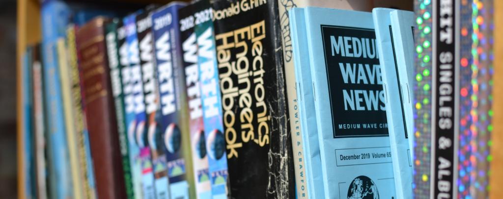 Library shelf featuring Medium Wave News magazines - photo by Steve Whitt